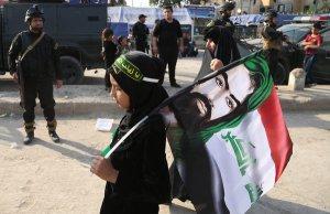 A Shiite pilrim w flag of martyr Iman Hussein